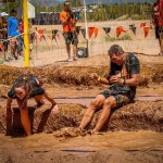 Dr Jeff Banas getting a little electric shock therapy at Tough Mudder